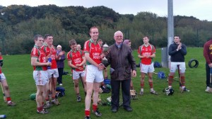 William Spillane receives the trophy from Don Hegarty on behalf of the East Cork Board