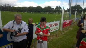 Captain Billy accepting the cup on behalf of the team