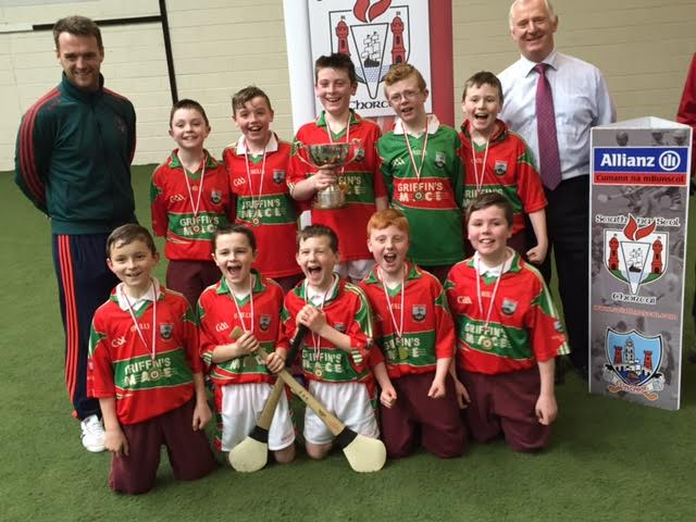 The Scoil an Athar Tadhg Carraig na bhFear team that captured the County Section Rang 4 Indoor Hurling Tournament with their Coach Mr. Diarmuid O'Driscoll and Principal Dermot O'Driscoll.