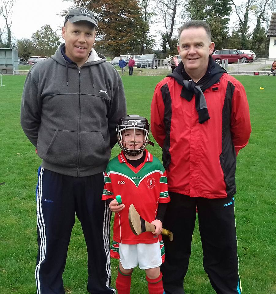 Chris O' Keeffe with trainers Denis Harte and Mike Flynn